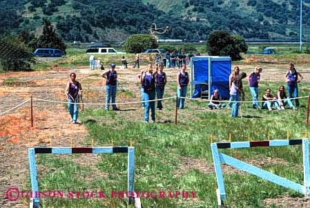Stock Photo #4009: keywords -  activity adolescent children club cooperate craft female girl group heaving horz learn line mariner practice rope scout scouts skill summer team teenage throw together