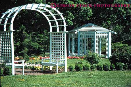 Stock Photo #4027: keywords -  arch decorate design exterior flower gazebo grid home horz house landscape lawn residential square structure trellis white wood yard