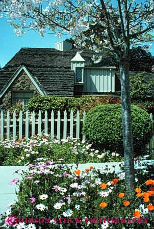 Stock Photo #4037: keywords -  blossom daises decorate design exterior fence flower fruit home house landscape picket residential tree vert yard