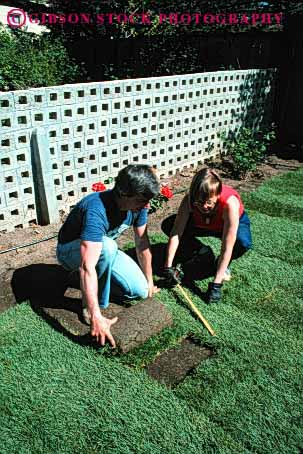 Stock Photo #4063: keywords -  accomplish backyard build cooperate couple decorate design garden gardening grass green home house improvement labor landscape lawn lay outdoor released share sod team together vert work yard