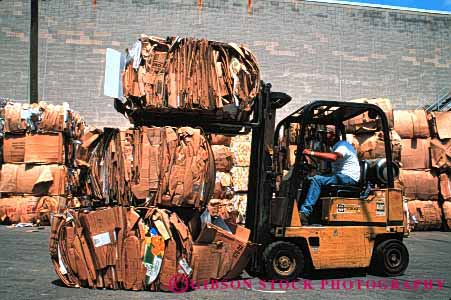 Stock Photo #4089: keywords -  bale cardboard compact compress equipment fork heavy horz industry lift machine material recycle recycling resource reuse site station