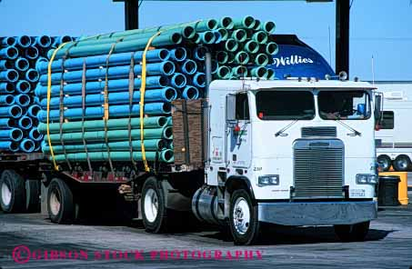 Stock Photo #4109: keywords -  heavy horz industry load parallel pipe transport transportation truck turquoise water