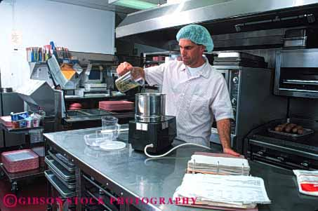 Stock Photo #4116: keywords -  appliance cook cooking employee food horz hospital institution job kitchen labor man metal occupation pour prepare process profession released service stainless steel