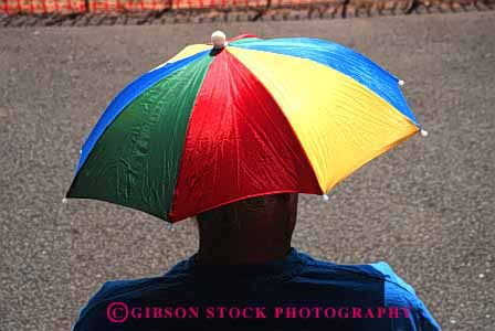 Stock Photo #4147: keywords -  clothing color colorful cover hat head horz shade style umbrella