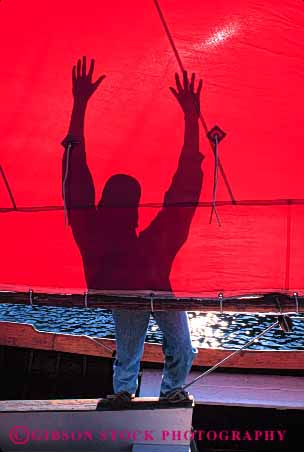 Stock Photo #4149: keywords -  abstract contrast dark light man red sail shadow silhouette vert