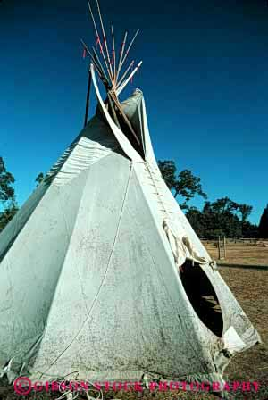 Stock Photo #4158: keywords -  american canvas cone geometric geometry historic home house indian native plains pole poles portable primitive pyramid replica replicas residence shelter shelters teepee teepees tent tepee tepees tipi tipis tradition triangle vert west