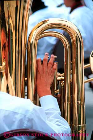 Stock Photo #4180: keywords -  band brass contour create curve equipment hand instrument metal music musical noise note perform practice shiny show sound tool tuba vert wind