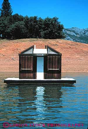 Stock Photo #4187: keywords -  boaters building california float floating for lake out outhouse raft restroom shack shasta toilet vert