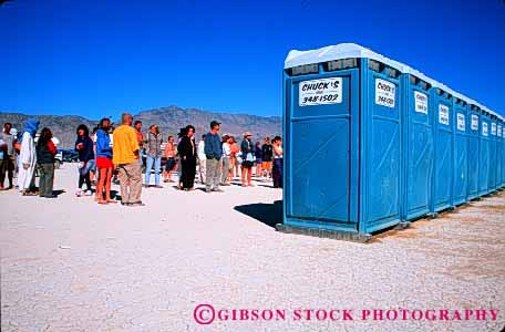 Stock Photo #4188: keywords -  building crowd desert horz houses line out outhouse outhouses people plastic restroom row shack toilet wait waiting