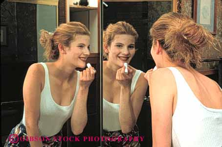 Stock Photo #4229: keywords -  appearance apply beauty cosmetic esteem home horz looks make mirror preparation reflection released self smile teenage teenager up woman young