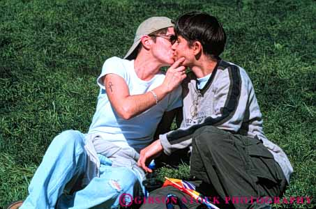 Stock Photo #6151: keywords -  affection attraction commitment controversial controversy couple embrace gay homo homosexual homosexuality horz immoral kiss lesbian love pair people released romance romantic same sex sexual sexuality sexy together two