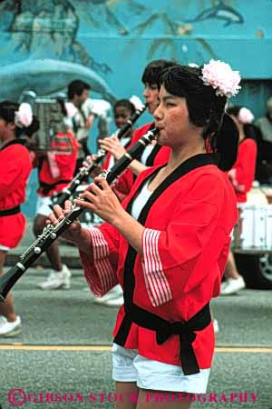 Stock Photo #4238: keywords -  annual asian blossom celebrate celebration cherry clarinet color colorful dance display ethnic event festival francisco japanese minority music parade performance san show together unity vert woman