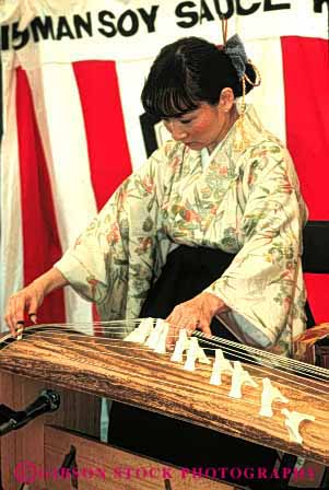 Stock Photo #4248: keywords -  annual asian blossom celebrate celebration cherry color colorful dance display ethnic event festival francisco instrument japanese japantown koto minority music performance play san show string together tradition unity vert woman