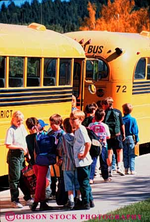 Stock Photo #4267: keywords -  adolescent board boy boys bus child children class educate education elementary forth fourth girl girls grade group kid kids learn line school students together transportation vert wait yellow young youth