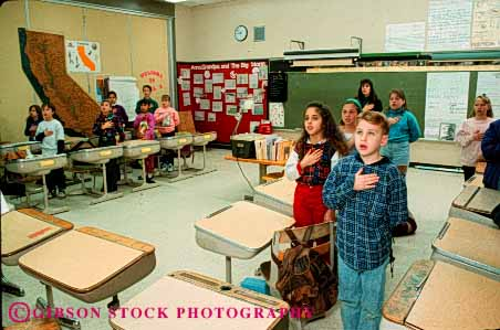 Stock Photo #4290: keywords -  adolescent allegiance americana boy boys child children class classroom coordinate educate education elementary ethnic forth fourth girl girls grade group horz kid kids learn mix oath of pledge recite released ritual school speak students study symbol together young youth