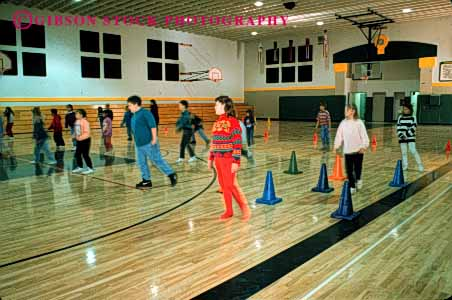 Stock Photo #4292: keywords -  adolescent boy boys child children class educate education elementary exercise forth fourth girl girls grade group gym horz kid kids learn movement physical released school students study together train training young youth