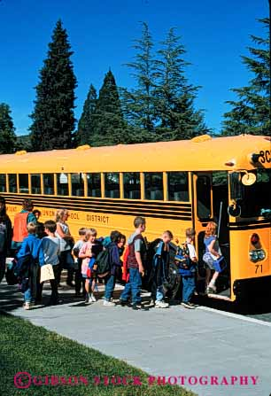 Stock Photo #4298: keywords -  adolescent after board boy boys bus busing child children class educate education elementary first girl girls grade group learn line school students study summer together transport transportation vert wait young youth
