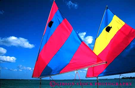 Stock Photo #4345: keywords -  blue boats bright color colorful craft fish float horz nassau pair recreation red sail toy triangle tropical vacation vessel water