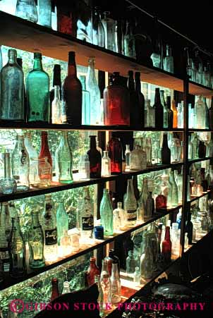 Stock Photo #4365: keywords -  antique bottle bottles collectors container display glass historic item jerome old pattern row sale sales sell translucent transparent vert vintage window