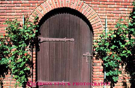 Stock Photo #4375: keywords -  arch architecture brick custom design door doorway entrance entry frame front horz old pattern rose traditional wood