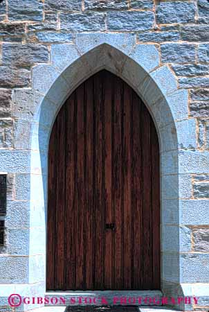 Stock Photo #4379: keywords -  arch architecture church custom design door doorway entrance entry frame front keystone pattern stone vert wall wood