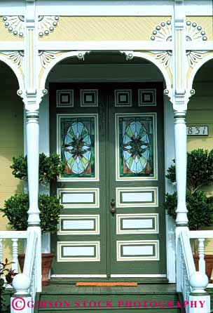 Stock Photo #4380: keywords -  arch architecture custom decorate decorated design door doorway entrance entry fancy frame front gingerbread green home house ornate pattern tradition traditional trim vert victorian vintage wood