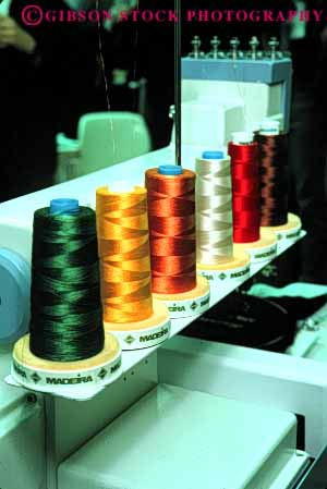Stock Photo #4413: keywords -  color colorful commercial cone create fabric feeder machine manufacture manufactured manufacturing rotate round row sew sewing spools string supply thread vert