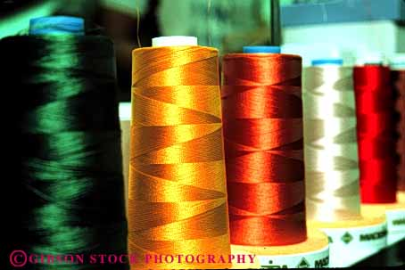 Stock Photo #4414: keywords -  color colorful commercial cone create fabric feeder horz machine manufacture manufactured manufacturing rotate round row sew sewing spools string supply thread