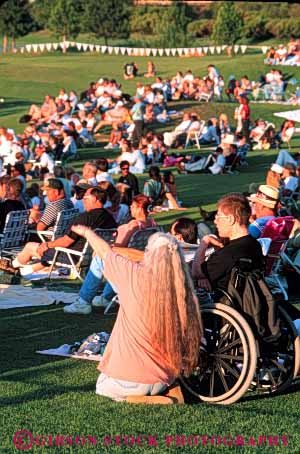 Stock Photo #4453: keywords -  access challenge challenged concert crowd disability disabled disadvantage disadvantaged handicap handicapped impair impaired man need needs outdoor special summer vert wheelchair