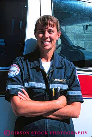 Stock Photo #4464: keywords -  aid ambulance career emergency emt female first income job medical medicine nurse occupation paramedic paramedics released rescue respond save smile technician treat treatment uniform vert vocation woman work worker