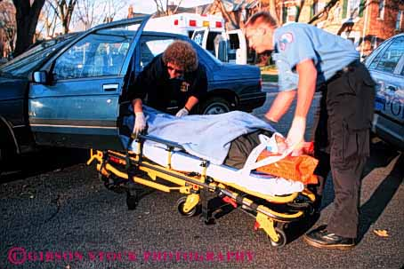 Stock Photo #4471: keywords -  accident aid ambulance auto automobile body car career collision damage emergency emt first horz hurry hurt income injury insurance job medical medicine move nurse occupation pair paramedic paramedics rescue respond rush save team technicians treat treatment vehicle victim vocation work worker