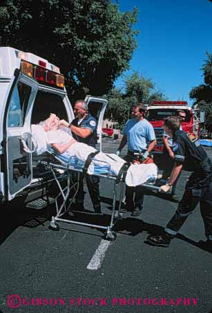 Stock Photo #4477: keywords -  aid ambulance body career damage elderly emergency emt first hurry income injury insurance job medical medicine move nurse occupation old paramedic paramedics rescue respond rush save senior sick technician treat treatment vehicle vert vocation woman work worker