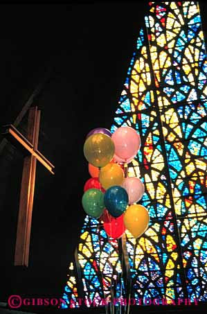 Stock Photo #4495: keywords -  balloon balloons church creed cross denomination divine divinity faith glass god higher holy persuasion power religion religious spirit stained theology vert window worship