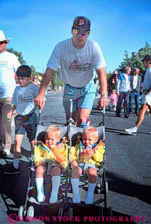 Stock Photo #4510: keywords -  babies bbay boys brother brothers child children father identical look people same sibling stroller twin twins two vert