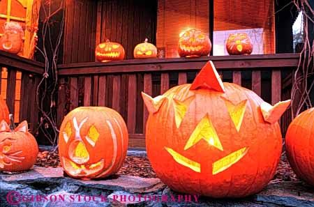 Stock Photo #4640: keywords -  angle autumn candle carve carved face fall geometric geometry halloween harvest holiday home horz house jack lantern lanterns light o orange outdoor outside porch pumpkin pumpkins round season silhouette triangle