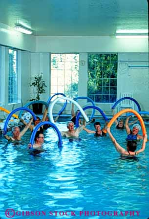 Stock Photo #4694: keywords -  aerobic aerobics being body class classes condition conditioning elderly exercise exercising group guide heal healing health healthy improve improvement injury learn mature medical medicine old older patient patients people person physical pool professional recover recovering recovery released senior seniors sports swim teach therapist therapy trained treat treating treatment vert water well
