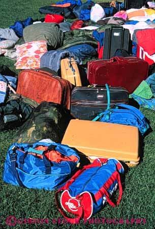 Stock Photo #4726: keywords -  bag clothes clothing contain container disorganized duffel lawn luggage overnight pile sleeping suitcase travel travelers vacation variety vert
