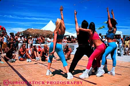 Stock Photo #4738: keywords -  aerobic beach color colorful coordinate coordinated costume dance dancers dancing display dress exercise fitness group horz miami move movement music musical outdoors outside perform performance performers performing practice routine show stage team together traditional
