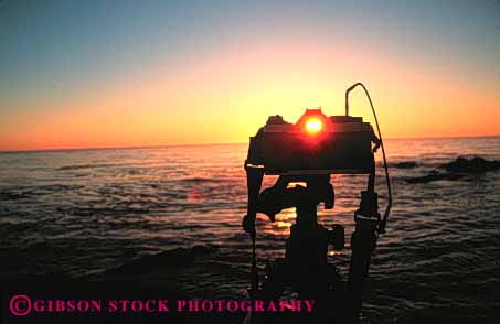 Stock Photo #4803: keywords -  camera cameras dawn dusk equipment horz ocean orange photo photographer photography picture seascape see sunrise sunset tool view