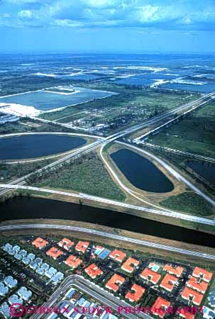 Stock Photo #4809: keywords -  aerial area building city civilization community convert cover development engulf everglades expand florida grow growing growth habitat highway highways houses housing in interchange interstate loss metropolitan miami neighborhood out over sprawl spread take transportation urban urbanization vert wetlands
