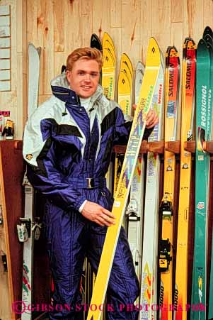 Stock Photo #4817: keywords -  browse business buy buyer clothes clothing coat commerce consumer customer display economics economy equipment examine gear jacket look man merchandise outfit purchase purchasing released retail sale see sell shop shopper shopping ski skis snow spend sport store vert winter