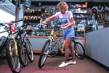 Stock Photo #4824: keywords -  bicycle bike browse business buy buyer commerce consumer customer display economics economy equipment examine horz look merchandise purchase purchasing released retail sale see sell shop shopper shopping spend sport store summer woman