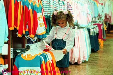 Stock Photo #4826: keywords -  browse business buy buyer child clothes clothing commerce consumer customer display economics economy examine five girl horz look merchandise old purchase purchasing released retail sale see sell shop shopper shopping spend store year