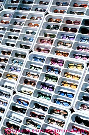 Stock Photo #4843: keywords -  advertise business commerce consume consumerism display economics economy enterprise exhibit glasses grid inventory merchandise merchandising pattern plastic present product products promote retail retailer sale sales sell selling store summer sun sunglasses trade vert