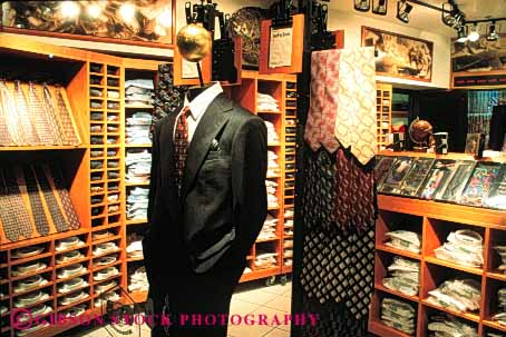 Stock Photo #4852: keywords -  advertise business clothing commerce consume consumerism display economics economy enterprise exhibit fancy horz inventory mens merchandise merchandising present product products promote retail retailer sale sales sell selling store suit tie trade