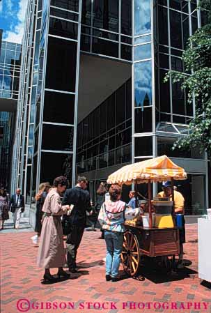 Stock Photo #4869: keywords -  beverage business cart city commerce downtown drink drinks eat economics employee food juice little lunch mobile movable one people person portable retail sell seller selling serve service small snack street vendor vert wagon