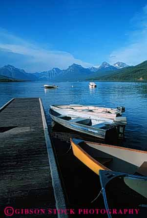 Stock Photo #4909: keywords -  boat boats calm dock glacier lake landscape mcdonald mountain mountains national park quiet scenic shore vert water wood
