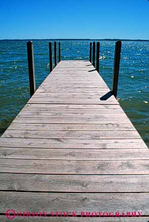 Stock Photo #4911: keywords -  boat calm dock horizon lake landscape michigan parallel pattern scenic shore vert water wood