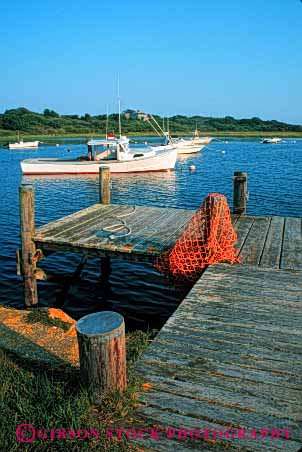 Stock Photo #4913: keywords -  atlantic boat boats calm cape chatham coast cod dock landscape massachusetts motorboat ocean scenic sea seascape shore vert water wood