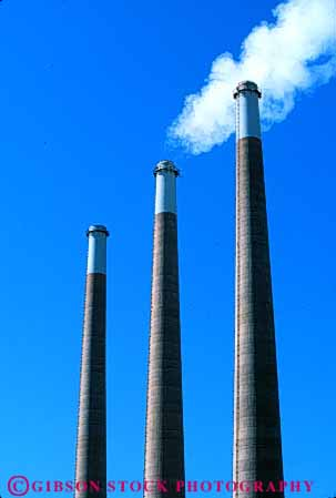 Stock Photo #4977: keywords -  air aviation cylinder cylindrical discharge emission exhaust factory hazard hollow industrial industry parallel pollution quality round smoke stacks steam tall three tube vert